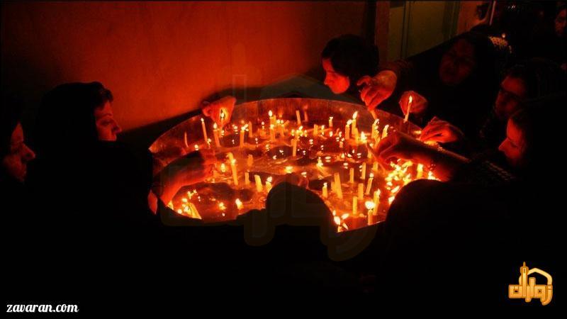 روشن کردن شمع در مشهد